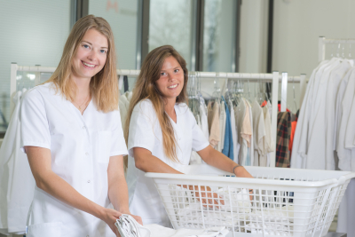 two caregiver working in laundry