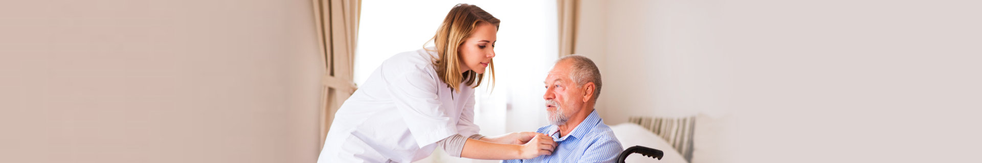 nurse fixing the collar of the old man