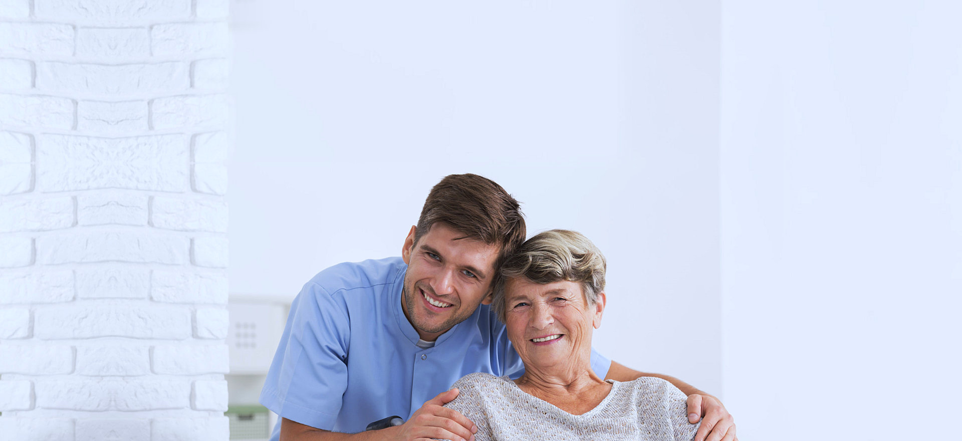 an elderly woman smiling with her caregiver