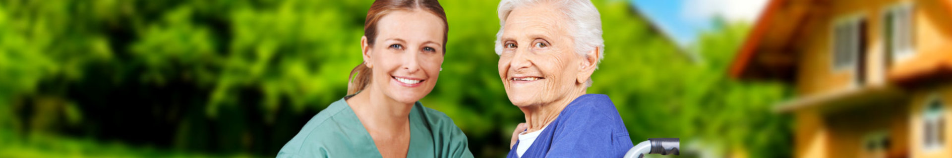an elderly woman and a caregiver smiling in front of the camera